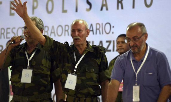 Brahim Ghali (C), newly elected Polisario secretary general and president of the self-proclaimed Sahrawi Arabic Democratic Republic, gestures during the PF's extraordinary congress on July 9, 2016 at the Sahrawi refugee camp of Dakhla, 170 kms to the southeast of the Algerian city of Tindouf, in the disputed territory of Western Sahara. - Western Sahara independence movement Polisario Front elected a founding member of the group as its new leader Saturday, Algeria's APS news agency said, after its head of 40 years died in late May. Ghali, 67-years-old, -- who represented the Algeria-backed movement in Madrid then in Algiers -- is to succeed Mohamed Abdelaziz, who spent decades fighting Morocco for the independence of the territory. (Photo by Farouk Batiche / AFP)